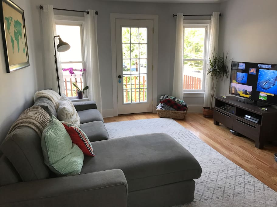 Living area on second floor with front deck access