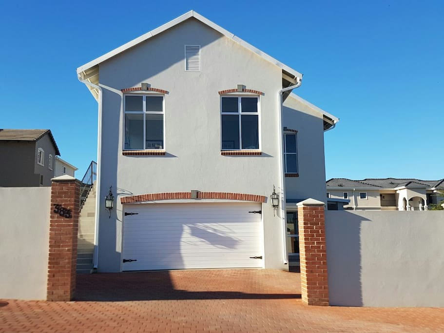 Main house. Private, secure parking with separate access to suite which is semi - detached to main house