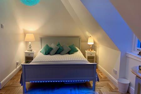 Spacious loft apartment with stunning sea views