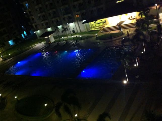 Night view of the pool from the balcony