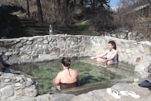 25km away there is few hot mineral springs with a healing water in the nature. Free of charge.