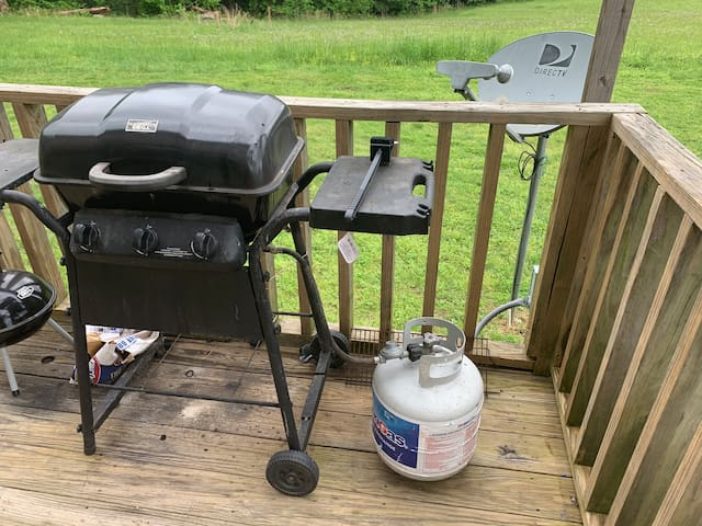 Propane grill on back deck.