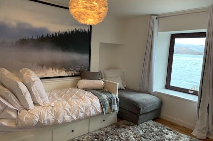 Bedroom three with views of Loch Broom