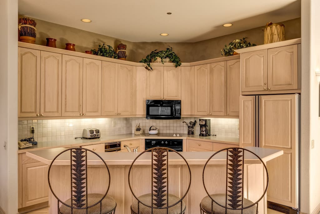 Pull up a chair at the kitchen island and keep the chef company.