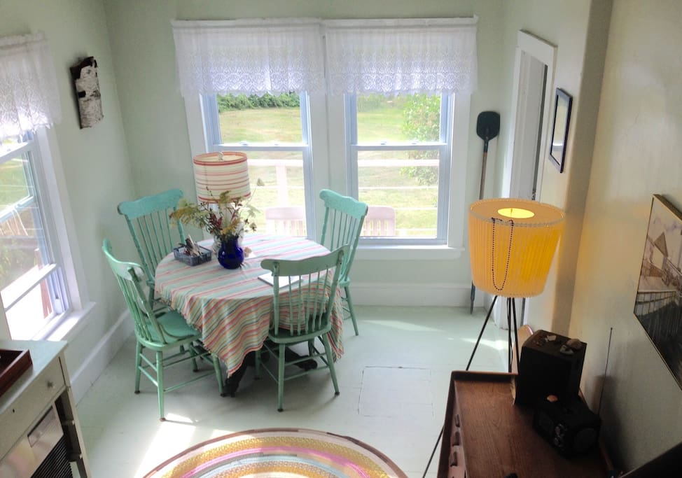 Bright living room dining room with drop-leaf table to seat eight.