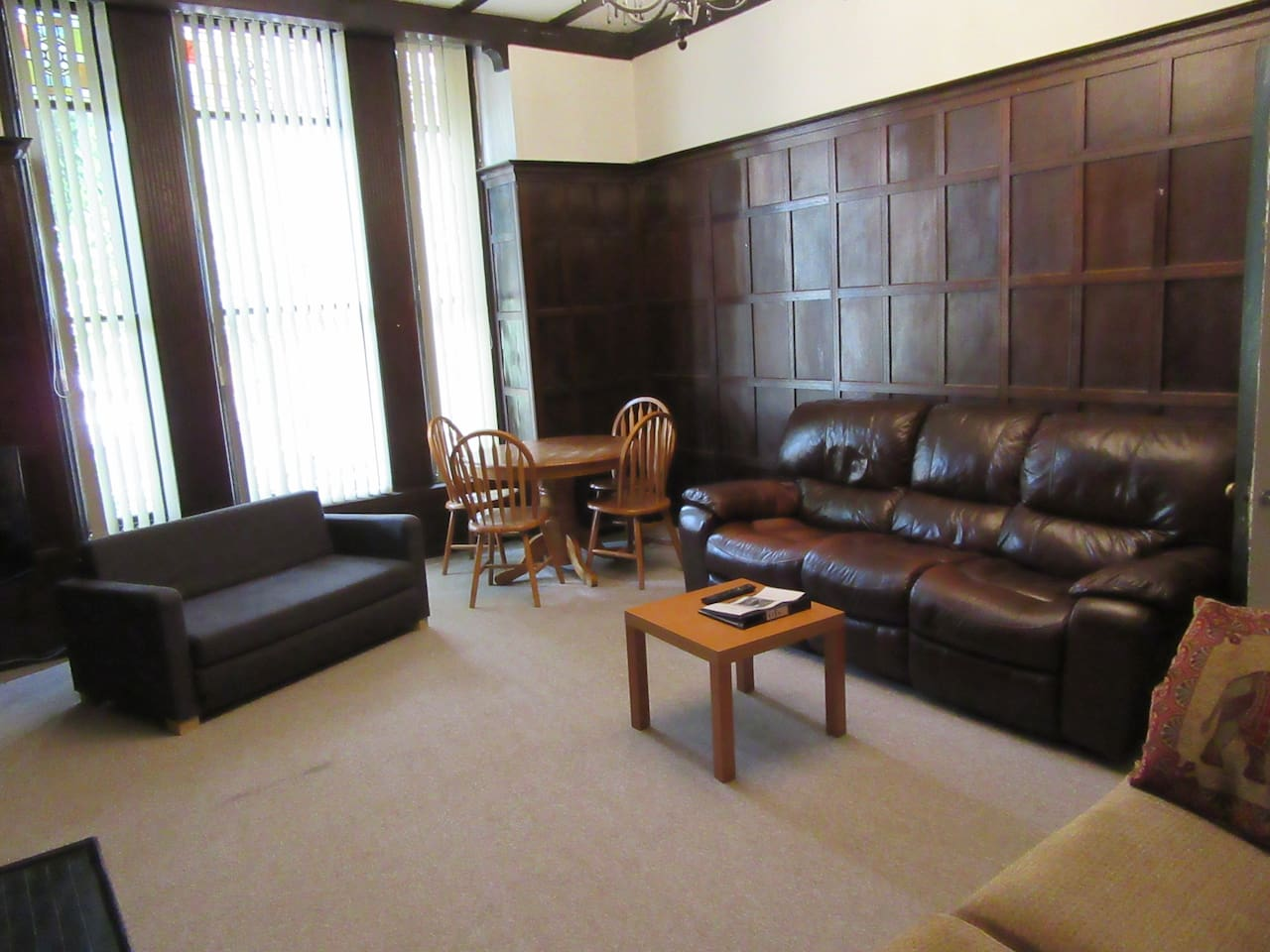 living room, with wood paneling