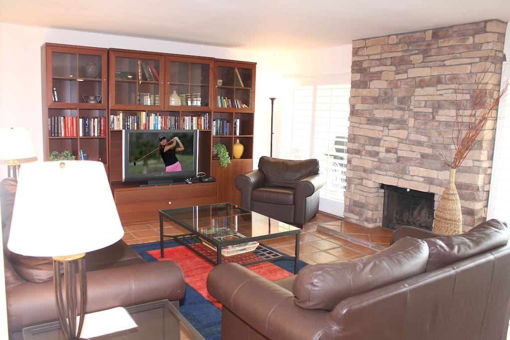 The spacious living room is the perfect gathering place for a group