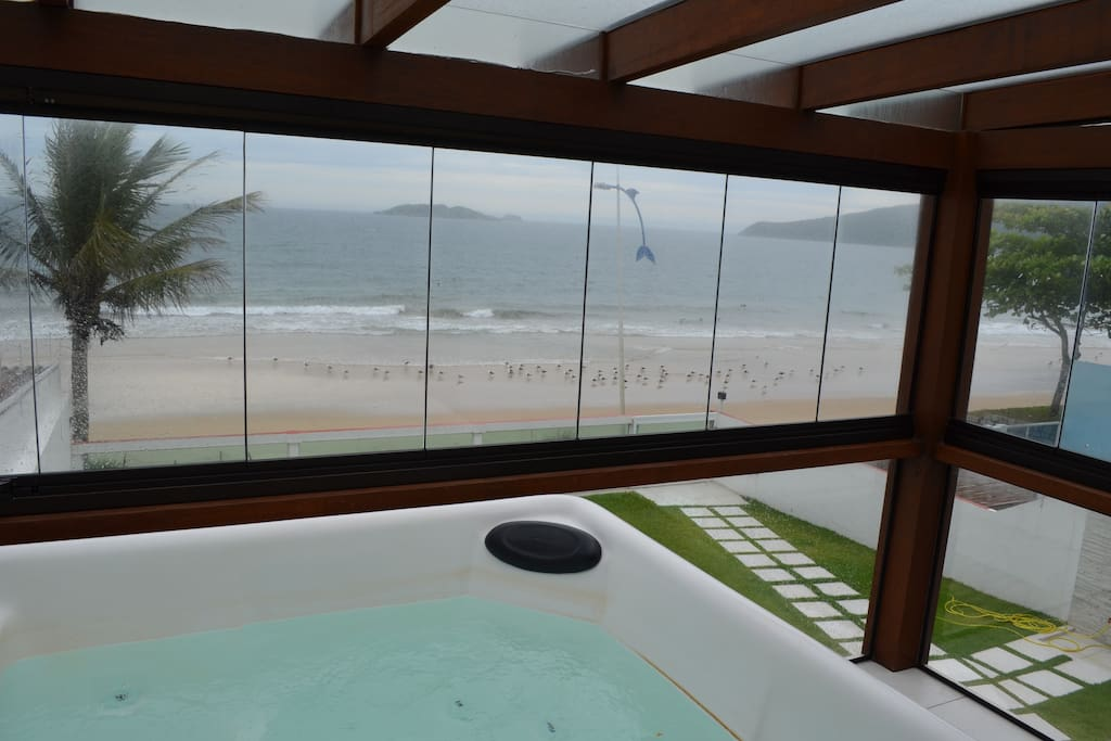 Hot tub in the ensuite bedroom - seagulls on the beach in a rainy day