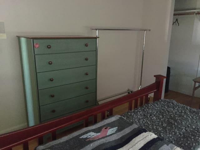 Dresser/clothes rack plus spacious closet to the right