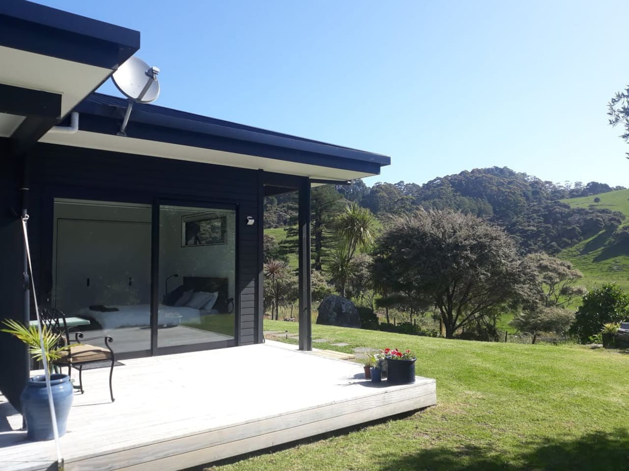 The bedroom and deck with rural views.
