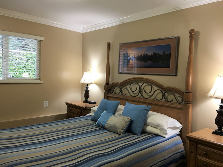 The master bedroom has a comfortable bed, and overlooks the pool and garden area.