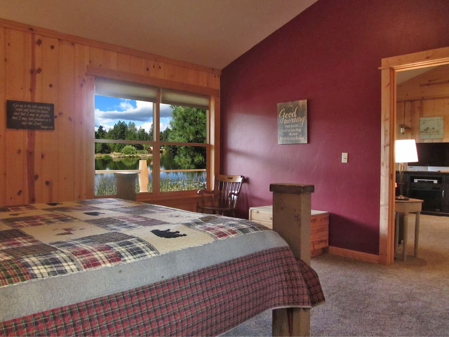 Great way to wake up in a King bed looking out to the pond and then into Living room