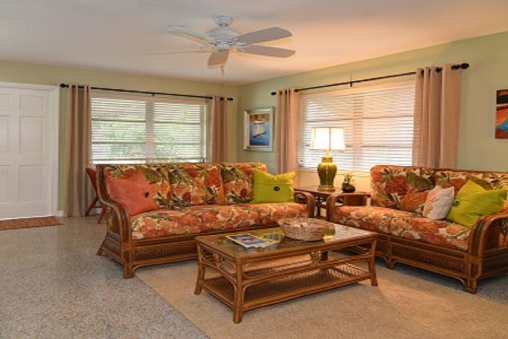 Numerous window provide lots of natural light and views of tropically landscaped yard.