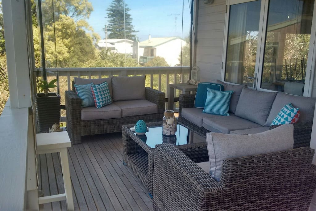 upstairs outdoor lounge area, 3 cafe blinds installed