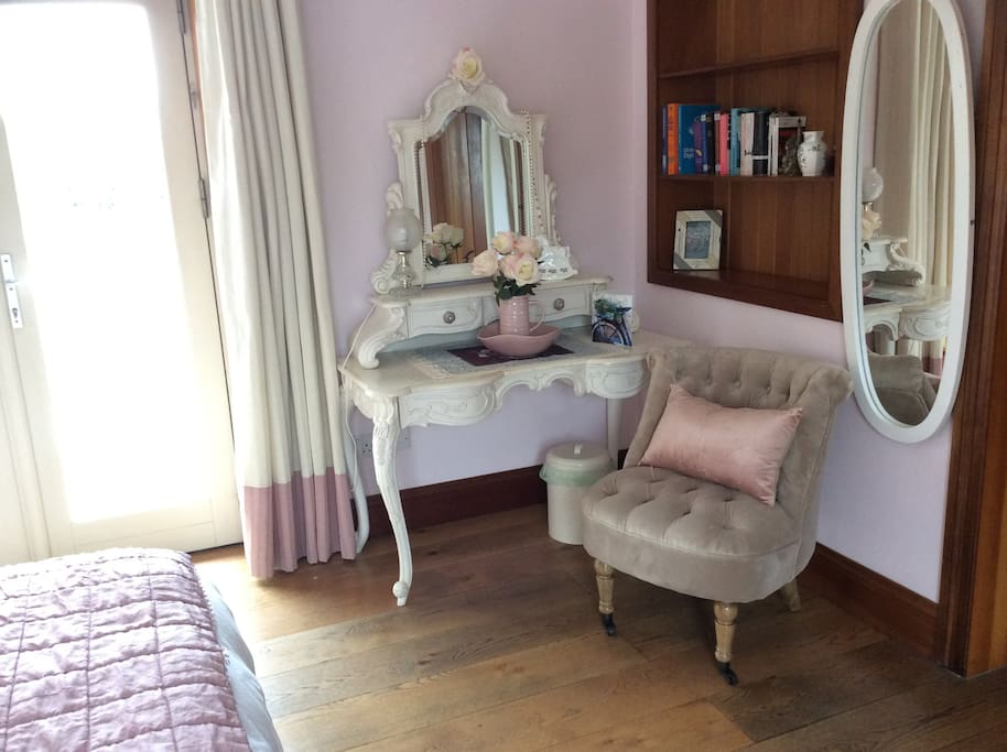 Large beautiful bright bedroom with Louis 16th style painted furniture.