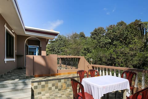 Open terrace with blue sky and greenery
