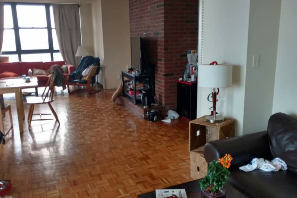 another view of the large open living space (bedroom is located behind the brick wall)