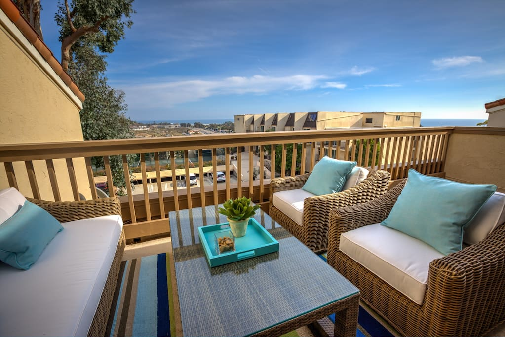 Comfortable outdoor seating on the patio with gorgeous ocean views