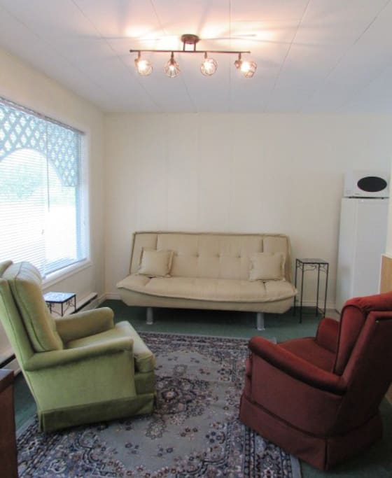 Living room with futon & swivel chairs