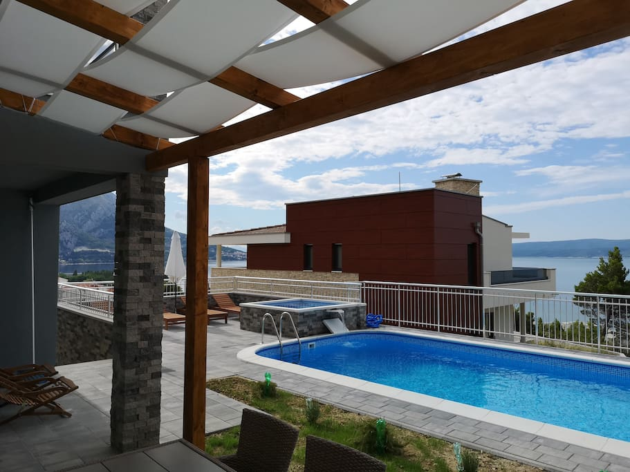 Swimming pool area and sunning terrace with great sea view