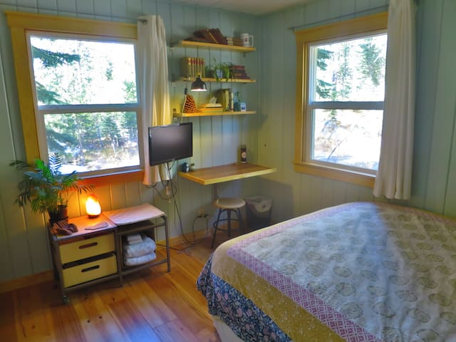 Your cozy private room with queen-sized bed, workspace, and new hardwood flooring