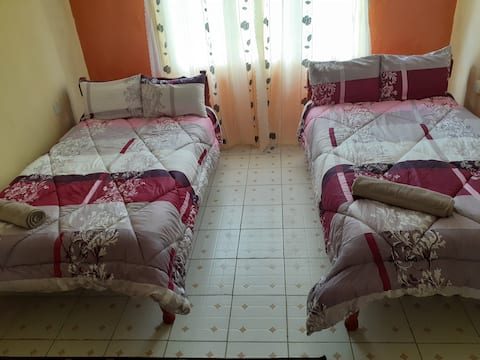 Shared room for cozy, convenient and restful stay.