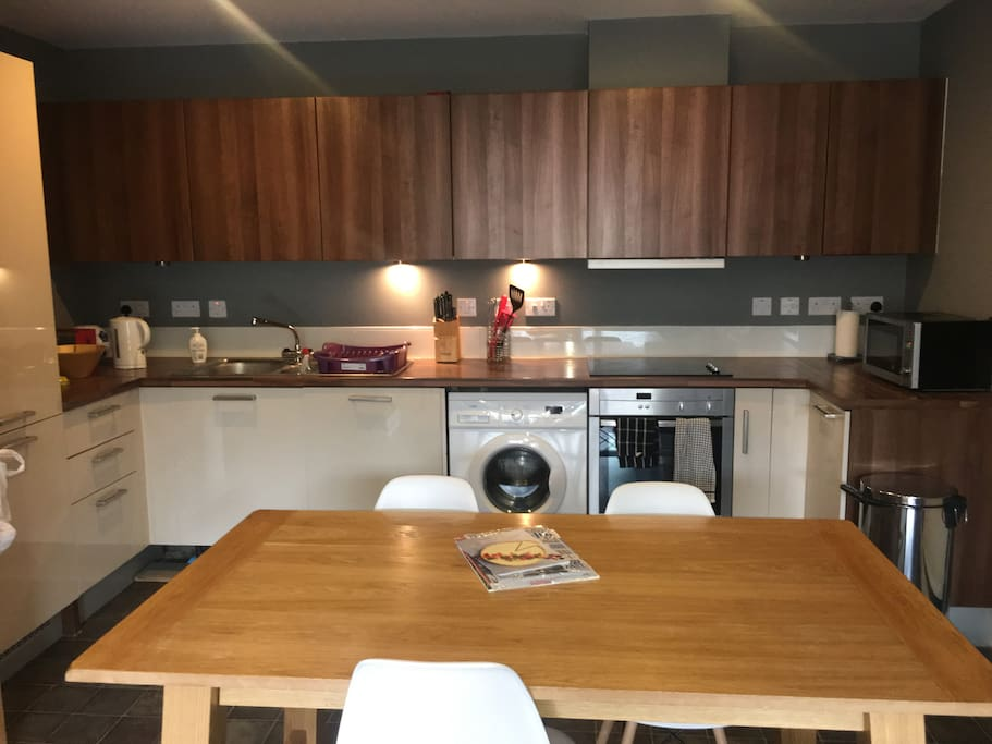 Open plan kitchen with all cooking utensils microwave, large fridge and freezer, washing machine (with two clothes rails to dry your clothes)