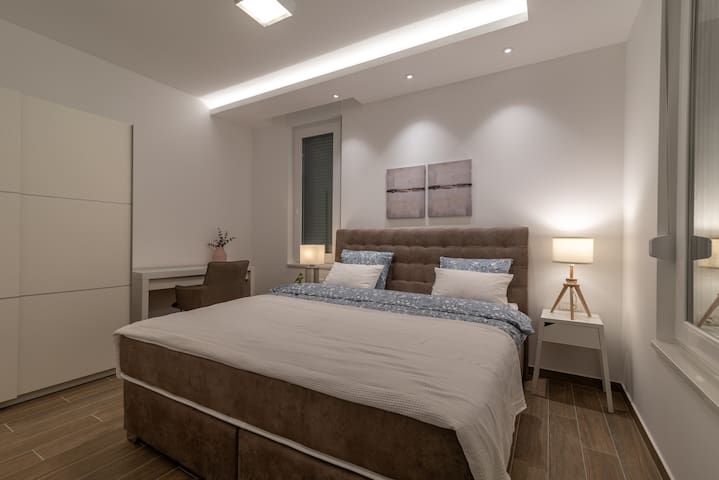 Bedroom 2 with extra large boxspring bed