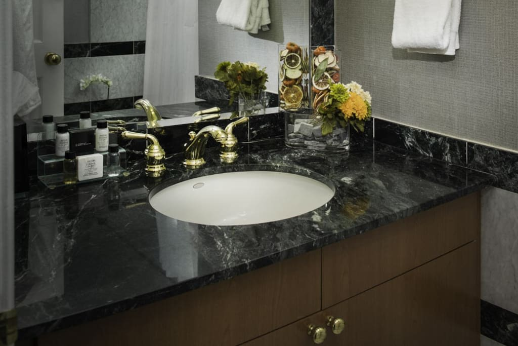 Marble counter in bathroom.