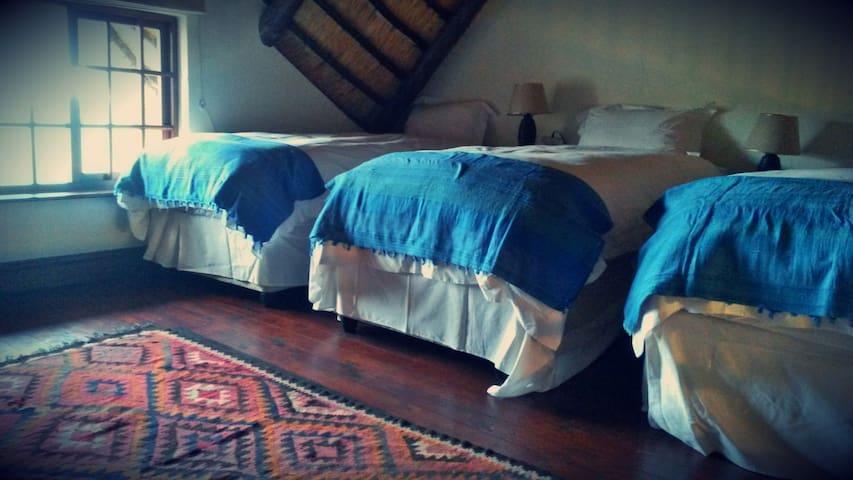 Mezzanine with three single beds