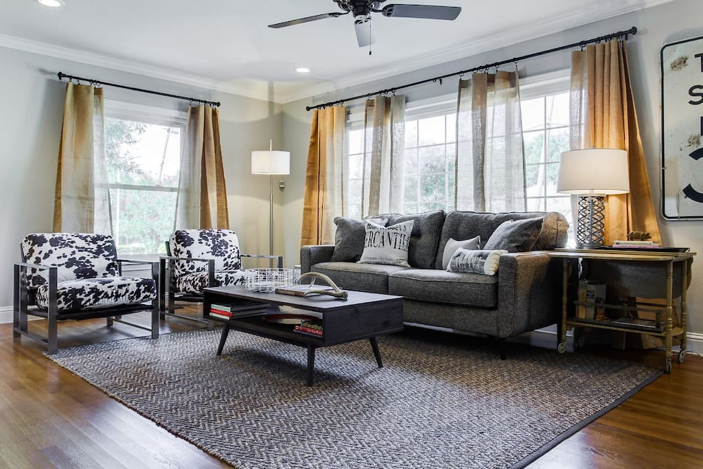 Open concept great room.  A mix of vintage charm and new furnishings. Relax and watch a movie or just enjoy time with family & friends.