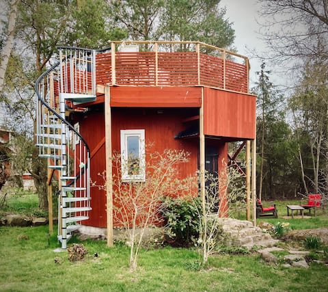 Tiny wooden tower house close to the seaside, 20m2
