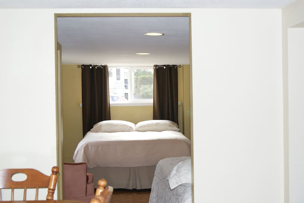 Large bedroom has a queen size bed and a double bed.