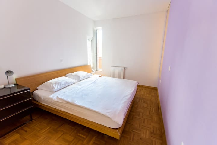 A master bedroom with double bed