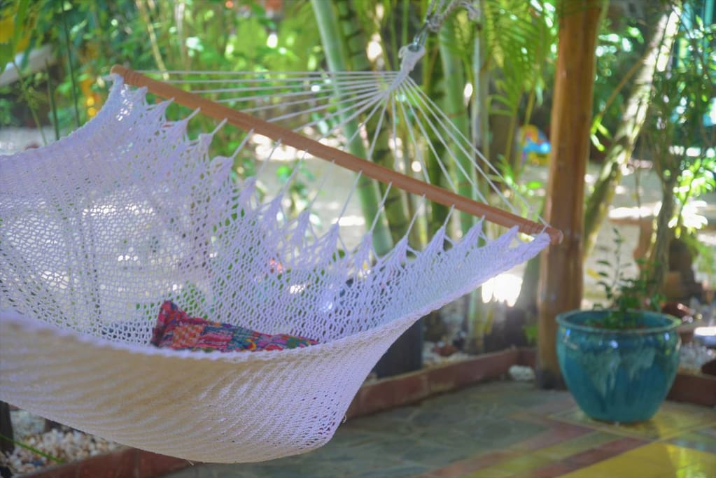 Enjoy lounging in one of the hammocks while the Ocean Breeze passes by
