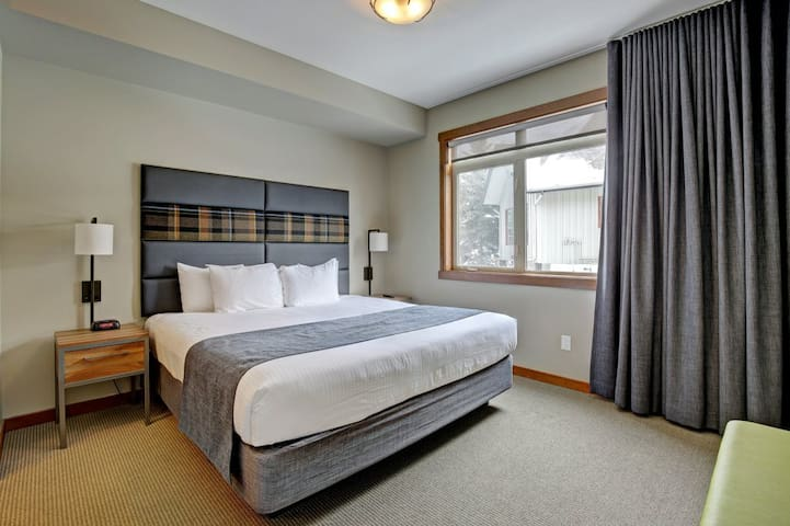 Deluxe bedroom #1 with a king bed and an en suite bathroom