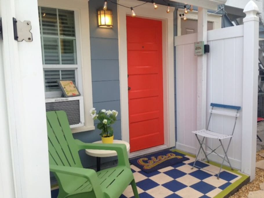 Studio private porch, window unit has been replaced. Cafe chairs and table are in place of the green chair.