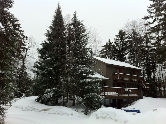 Hideaway Chalet in winter. View from private parking lot. Secluded in forest, yet in middle of it all. On ski slope in 3min.  Walk to restaurants and bars. Have them pick you up with complimentary shuttle.