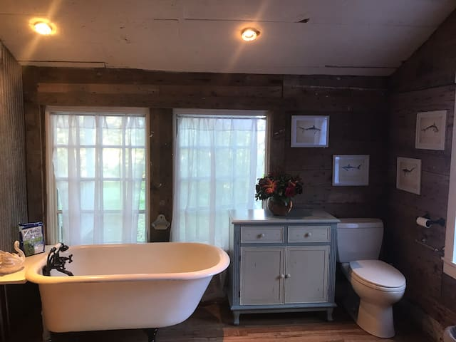 Clawfoot tub with a variety of soaking salts. There is also a small shower next to the tub (not shown)