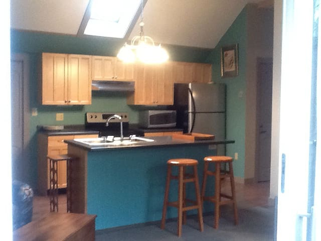 Remodeled kitchen with skylight. New appliances