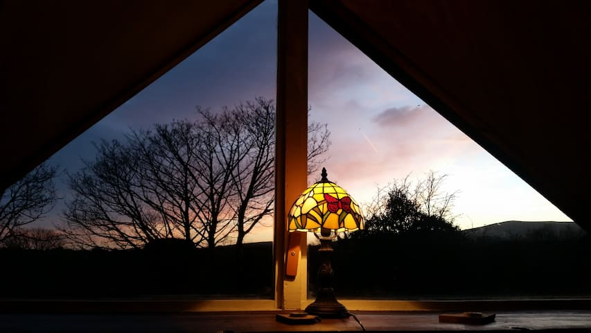 stunning night sky views of the heavens and the mountains from your bed