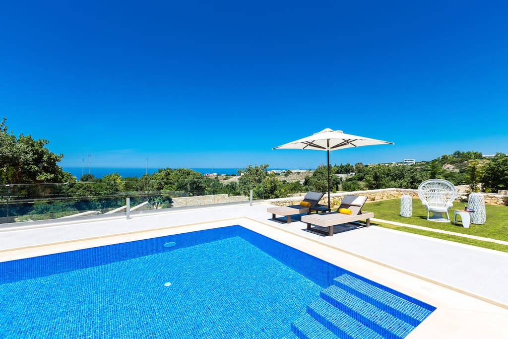 Swimming pool area with panoramic sea view