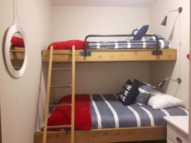 Twin mattress top bunk -Queen mattress on bottom bunk. 24 in smart TV