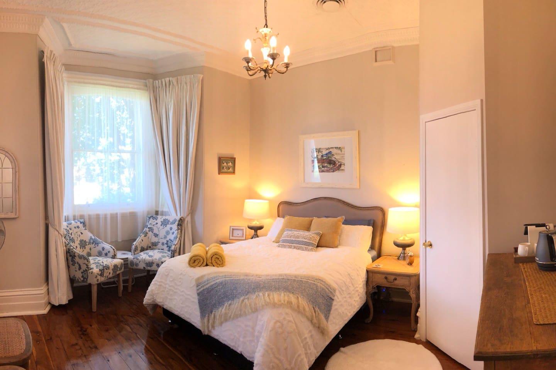 Your bedroom!  A super comfy Queen size bed. Your ensuite is just behind that door :)