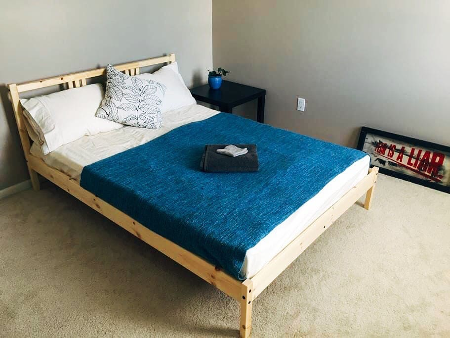 Full size bed sleeps two persons comfortably