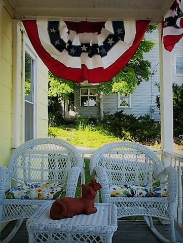 Patriotic front porch sitting...wicker chairs are very West Virginia!