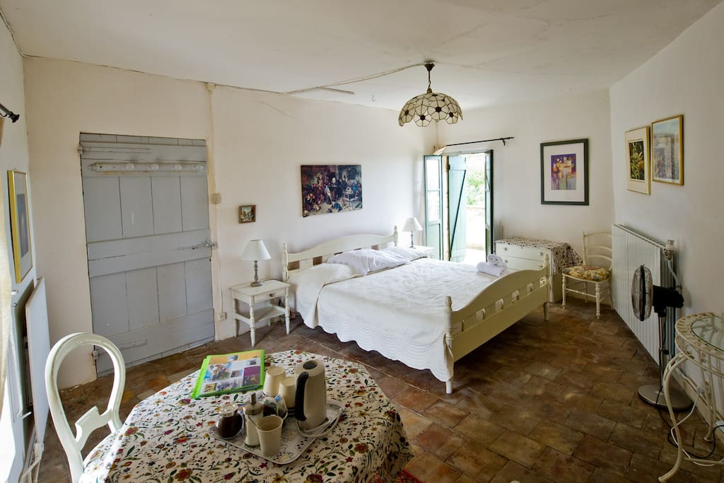 Top bedroom King size bed and private terrace with view over countryside