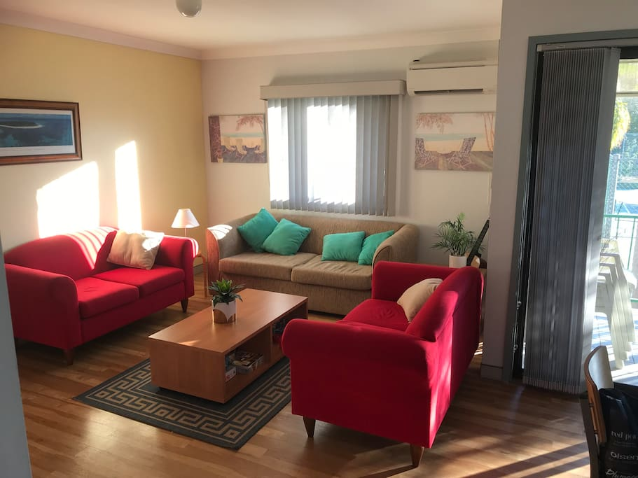 Sunny living. Double sofa bed in lounge for 5th guest. Overlooks pool and tennis court. Air conditioned.