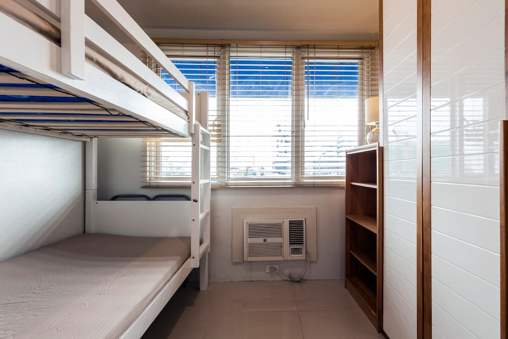 The bedroom is furnished with wooden bunk beds to maximize the space.