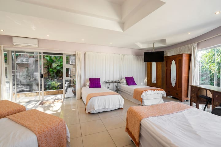Bedroom 6 en-suite. The bedroom leads out to a koi pond and roof top pool.